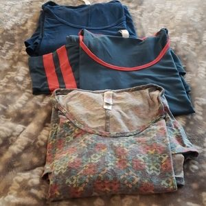 A bundle of 3 Lularoe Perfect T tops in size small